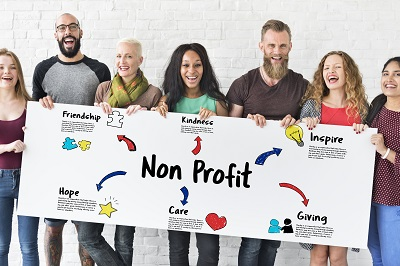 group of people holding a sign that reads non-profit
